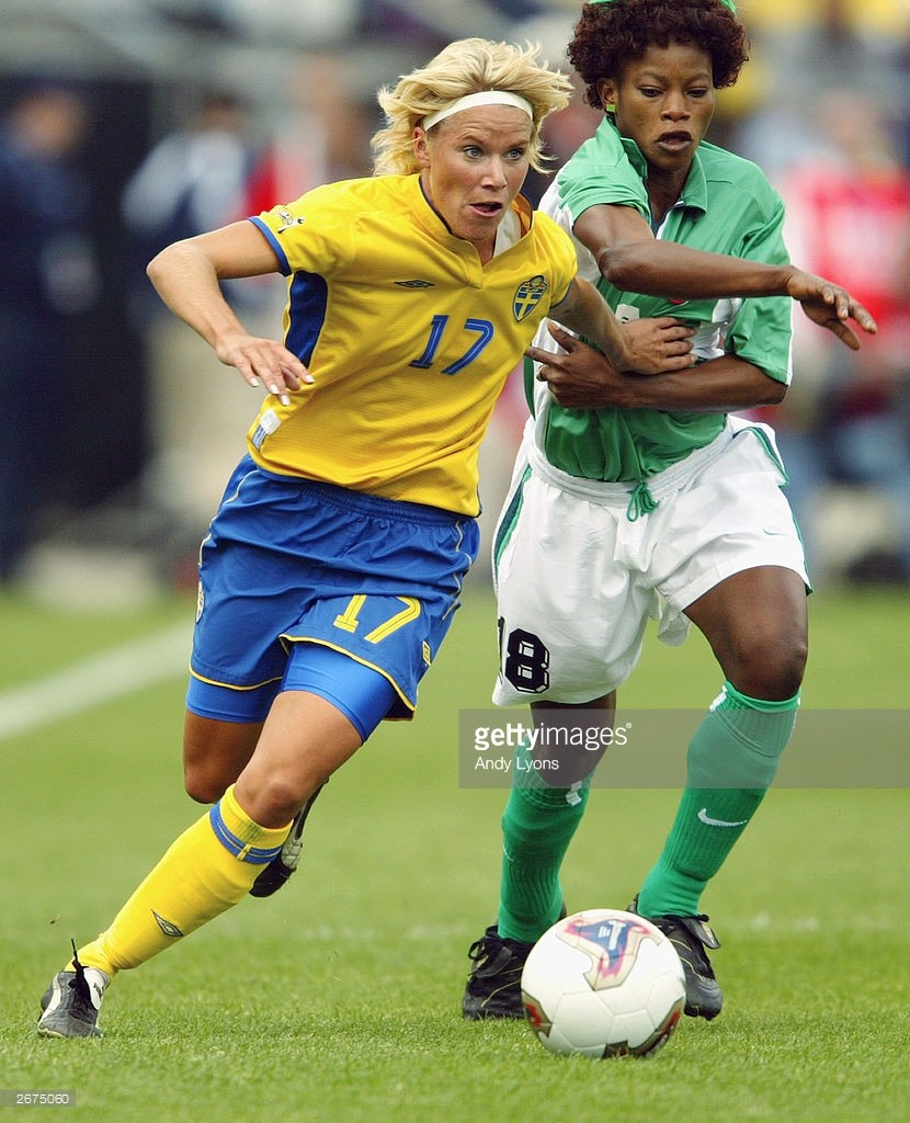 Nigeria's Patience Avre pressures midfielder Anna Sjoestroem of Sweden during the 2003 FIFA Women's World Cup at Crew Stadium on September 25, 2003 in columbus, Ohio. (Photo Credit: Getty images)