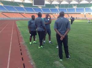 Oliseh and his assistants before the match in Tanzania.